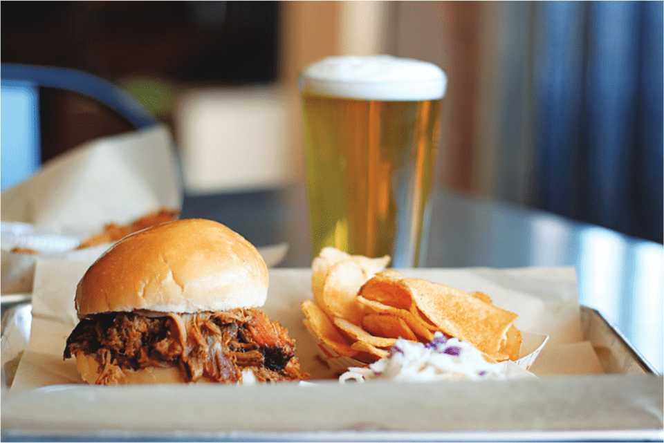 brisket sandwich, housemade chips, and beer